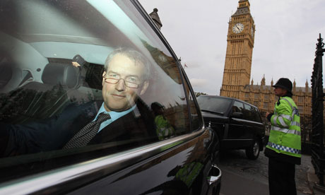 Owen Paterson, Secretary of State for Northern Ireland, leaves the Houses of Parliament