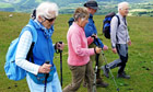 Country Diary : ell walkers with trekking poles on Latrigg above Keswick