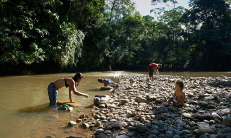 Family by Napo River, Amazon Rain Forest, Ecuador