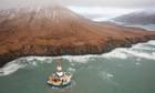 Sheel oil Arctic drilling rig Kulluk aground on the southeast shore of Sitkalidak Island
