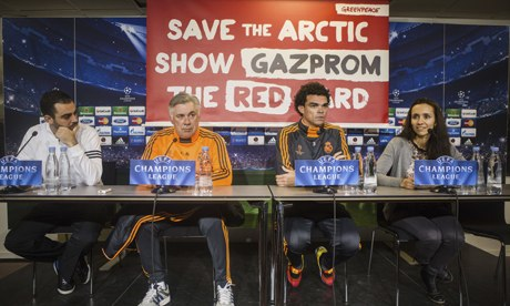 A Greenpeace Arctic campaign banner is seen during a press conference given by Real Madrid