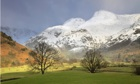 Country Diary : snow capped Langdale pikes on a stormy winters day