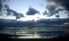 UK Spring Weather : Snow clouds over Tynemouth beach
