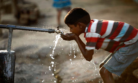 MDG An Indian boy drinks water from a roadside tap in Allahabad, India