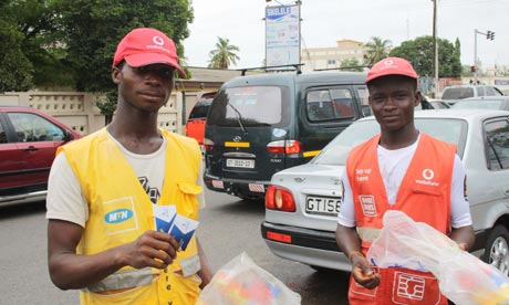 Street Sellers in Accra selling SMS cards and mobile phones
