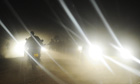 MDG : Road safety in Kenya : A man rides a motobike at night