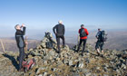 Country Diary : Fell runners and walkers on Bob Graham Round rest at the summit of Great Calva
