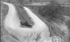 Country Diary Archive : circa 1910 A motorist takes U-shaped bend at Llandrindod Wells, Wales