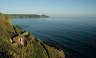 Country Diary : Rame Head on Whitsand Bay with chalets on the foreground Cornwall UK