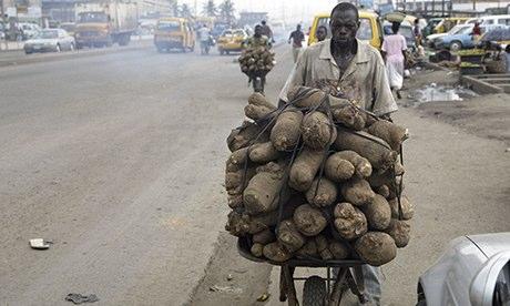 MDG : A street vendor hawks tubers of yam in Lagos, Nigeria