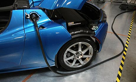Electric  Photo on Power Cable Is Seen Plugged Into A Tesla Roadster Electric Car In