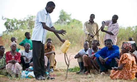 A co-ordinator instructs village health team members at a development project in Katine, Uganda