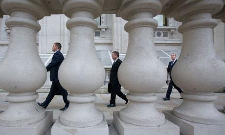 Civil servants go to work in Whitehall, London