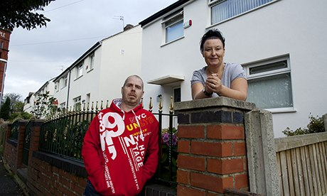 Alison Isaacs and her husband Darryl-Paul outside their home in Oldham
