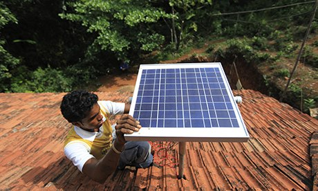 A solar panel is installed on the roof of a house near the south-west Indian port of Mangalore