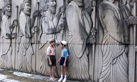 Two Parsi children chat outside a Zorastrian temple in Mumbai