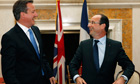David Cameron and French President Francois Hollande laugh at the end of their meeting in Washington