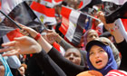Egyptian protesters shout slogans against President Morsi in Tahrir Square in Cairo