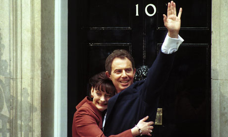 New Prime Minister Tony Blair and his wife Cherie Blair wave to the crowd