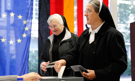 Two German nuns cast their votes in Berlin in Sunday's election.