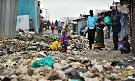 MDG : Poor and poverty : Nairobi's Mukuru -kwa-Njenga slum residents stand among rubbish, Kenya