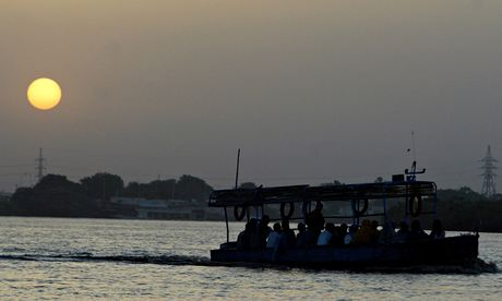 Sudanese villagers ride in their boat at the river Nile in Sudan's capital Khartoum