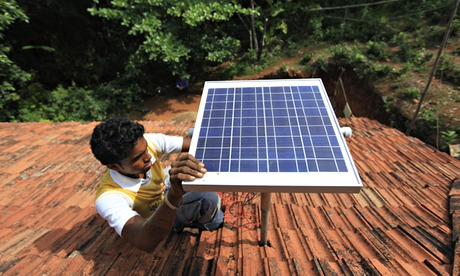 Cutting Co2 pollution : solar panel on the rooftop of a house in India