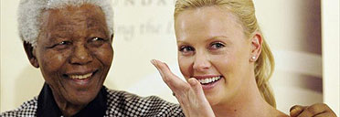 Nelson Mandela and Charlize Theron