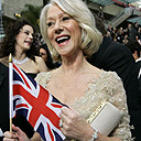Helen Mirren waving a union flag on the red carpet. Photograph: Amy Sancetta / AP