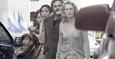 A still shot from the movie with one seeing woman leading a train of blind people behind her