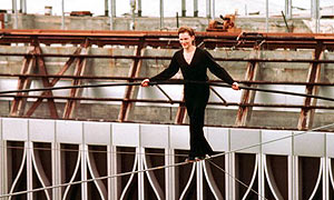 Philippe Petit walks on a cable suspended between the not-yet-completed twin towers of the World Trade Center in lower Manhattan, August 7, 1974