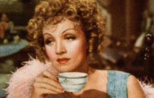 Marlene Dietrich with a cup