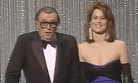Robert Mitchum and Sigourney Weaver at the 1983 Oscars