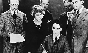 Charlie Chaplin signs the contract to establish United Artists on 17 April 1919