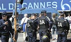 Policemen stand guard next to the Palais in Cannes