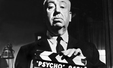 Alfred Hitchcock with the clapperboard Photograph Allstar Cinetext