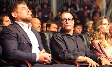 Ramzan Kadyrov, left, sits beside actors Jean-Claude van Damme and Hilary Swank at the celebration.