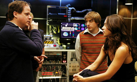Direct action … Joss Whedon (left) with the cast on the set of Dollhouse.