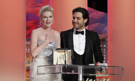 Cannes 2011 ceremony: Actress Dunst reacts next to actor Ramirez