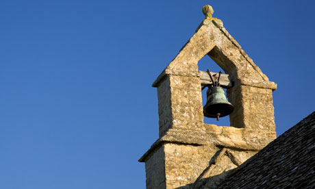 Bell tower of St Oswald's church in Widford Cotswolds Oxfordshire UK