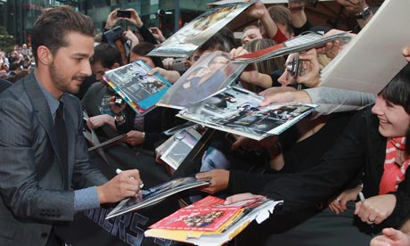 Shia LaBeouf sings autographs at the Transformers 3 German premiere