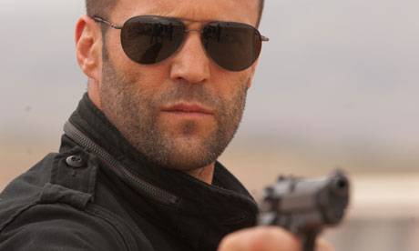 Jason Statham in Killer Elite - aviators plus gun