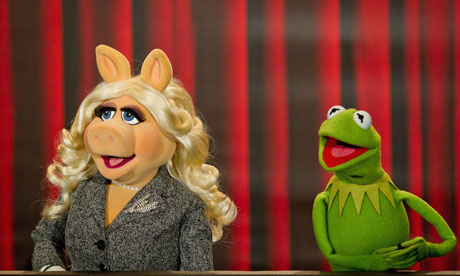 As green on screen … Miss Piggy and Kermit at a photo call for The Muppets in Germany last week.