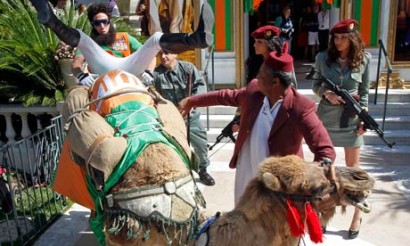 Sacha Baron Cohen sits on a camel during a photocall for The Dicatator on the Croisette in Cannes