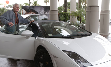 Easy rider … Outside the Carlton Hotel's Movie Stars Lounge, John Boorman hops into a Lamborghini