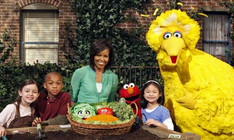 Street's ahead … Big Bird and Elmo with Michelle Obama and three guests in 2009.