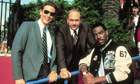 Judge Reinhold, John Ashton and Eddie Murphy on the set of Beverly Hills Cop II