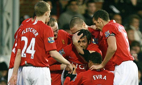 Tevez is congratulated by his team mates