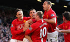 Manchester United celebrate their third goal having come from 2-0 down to beat Tottenham 5-2