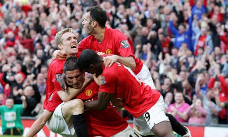 Manchester United's Federico Macheda celebrates scoring with teammates